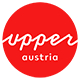 Logo Upper Austria Tourism: red circle with white upperaustria lettering